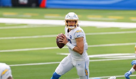 Justin Herbert, the NFL player you know as a quarterback for the Los Angeles Chargers may be a real star on the field but is he hanging out solo, off of it?